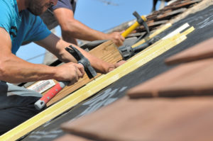 Two Roofers Repairing Roof